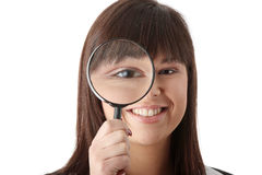 Business woman looking into a magniying glass Royalty Free Stock Photo
