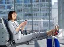 Business woman looking at mobile phone Royalty Free Stock Photo