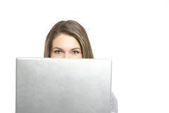 A business woman looking over her laptop Royalty Free Stock Photos