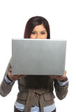A business woman looking over her laptop royalty free stock image