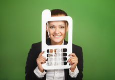 Business woman looking through paper mobile phone on green backg Stock Images