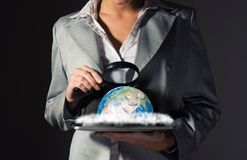 Business woman looking at the planet Royalty Free Stock Images