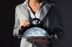 Business woman looking at the planet Stock Photo
