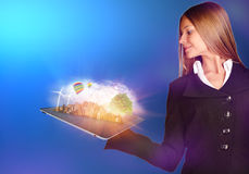 Business woman looking at the plate with city and Royalty Free Stock Photography