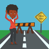 Business woman looking at road sign dead end. Royalty Free Stock Photos