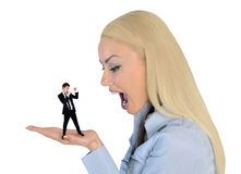 Business woman looking shocked on little man Royalty Free Stock Image