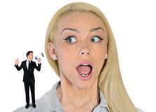 Business woman looking surprised on little man Stock Image