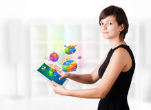 Business woman looking at tablet with pie charts Stock Photography