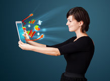 Business woman looking at tablet with pie charts Royalty Free Stock Images