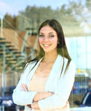 Business woman looking thtough window Royalty Free Stock Image