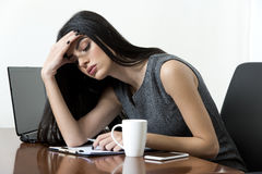 Business woman looking tired. Stock Images