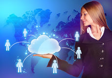 Business woman looking to the cloud with icons of Royalty Free Stock Photo