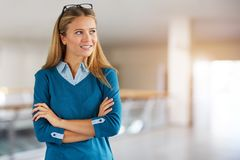 Business woman looking to the side in the corridor stock image