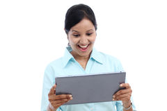 Business woman looking at touch pad PC Stock Image