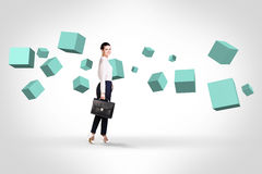 Business woman looking at turquoise cubes stock image