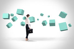Business woman looking at turquoise cubes royalty free stock photo