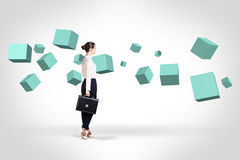 Business woman looking at turquoise cubes stock photography