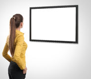 Business woman looking at tv Royalty Free Stock Photo