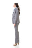 Business woman looking up Stock Photography