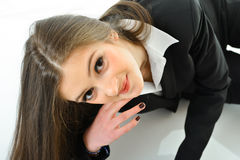 Business Woman Looking Up. Business woman laying down looking up Royalty Free Stock Photo
