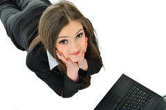 Business Woman Looking Up. Business woman laying down looking up Stock Photography