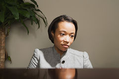 Business woman looking worried Royalty Free Stock Photos