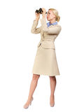 Business woman looks through binoculars. Successful business woman looks through binoculars into the future. Seeking for something. Isolated  white background Stock Photography