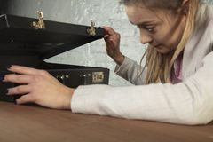 Business woman looks into the briefcase stock photo