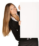 Business woman looks out from behind a blank white Stock Image
