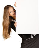 Business woman looks out from behind a blank white Stock Photo