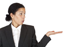 Business woman looks at palm with ad space Stock Photography