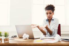 Business woman at a loss working on laptop at office stock photography