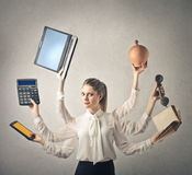 Business woman with lots of hands Stock Images