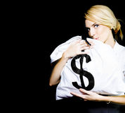 Business Woman In Love With Financial Success. Studio Image Of A Business Woman Kissing A Money Bag Full Of Monetary Gains And Earning In A Winning Business And Stock Photography