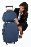 Business woman and luggages Stock Photography