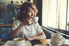 Business woman lunch in cafe during her work break Stock Photos