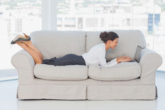 Business woman lying on couch Royalty Free Stock Photography
