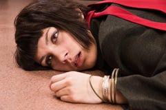 Business woman lying on the floor. Stock Photos