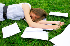 Business woman lying on the grass Stock Photography