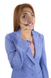Business woman with a magnifier. Stock Image