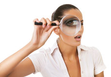 Business woman with magnifying glass on eye Stock Images