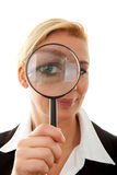 Business woman with magnifying glass to the eye Royalty Free Stock Photography