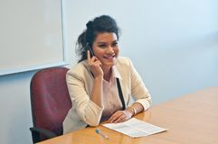 Business woman call to inquire more details about document. Business woman makes a call to inquire more details about document Royalty Free Stock Images