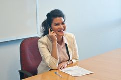 Business woman call to inquire more details and talk. Business woman makes a call to inquire more details and talk over phone Royalty Free Stock Images