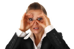 Business woman making bibunoculars with hands. Modern business woman making binoculars with hands and looking through isolated on white stock photo