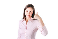Business woman making a call me sign and smiling. Royalty Free Stock Photo