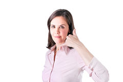 Business woman making a call me sign and smiling. Stock Photo