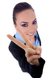 Business woman making her victory sign Stock Photos