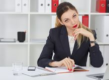 Serious business woman making notes at office workplace. Business job offer, financial success, certified public stock photos