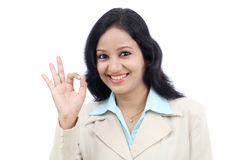 Business woman making Ok gesture Royalty Free Stock Images